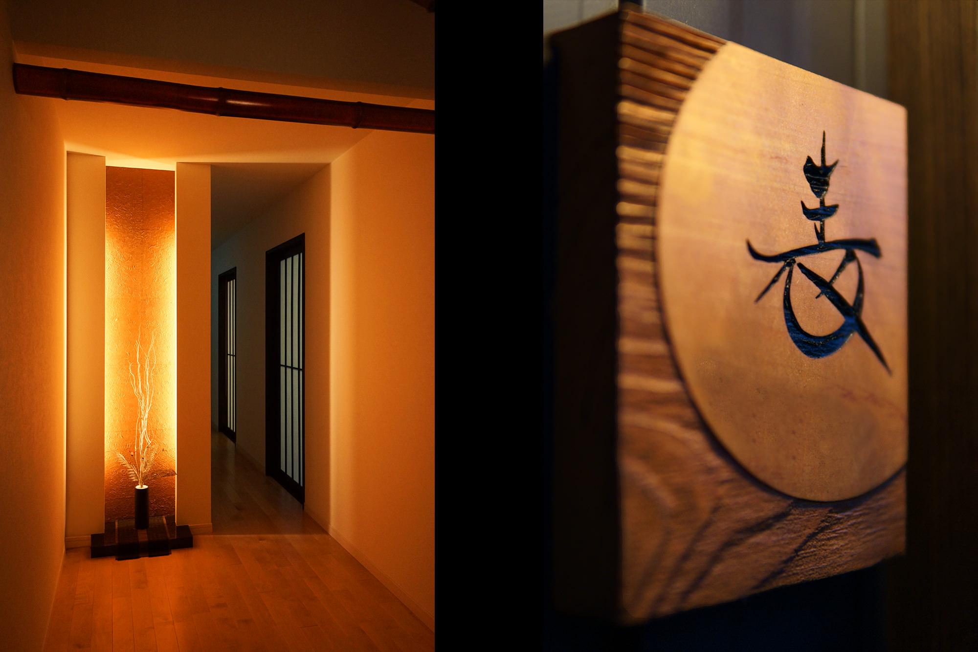 和モダン住宅の玄関と木の表札